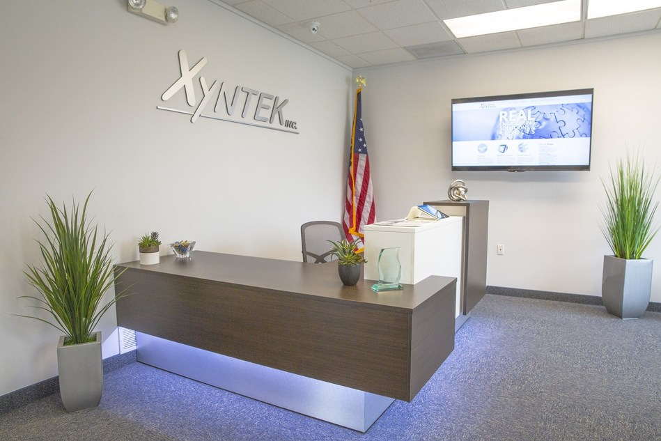 In 2015, Xyntek moved to a larger site, which expanded their Center of Excellence to accommodate the growing number of clients and employees.