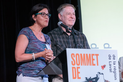 Marc Demers, maire de Laval, et Sylvie Lessard, présidente du Conseil régional de la culture de Laval s'adressent aux participants dans le cadre du Sommet de la culture. (Groupe CNW/Ville de Laval)