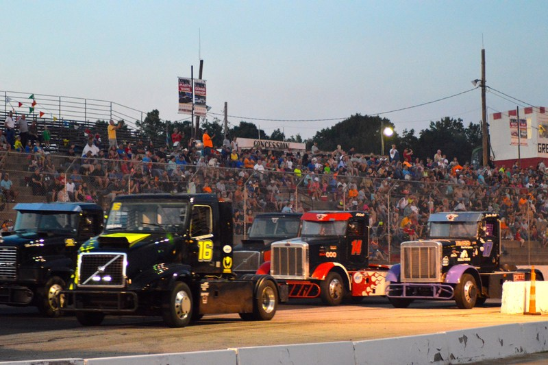 """""""The Minimizer Bandit Big Rig Series trucks line up in front of a packed house at Greenville-Pickens Speedway June 10, 2017."""""""