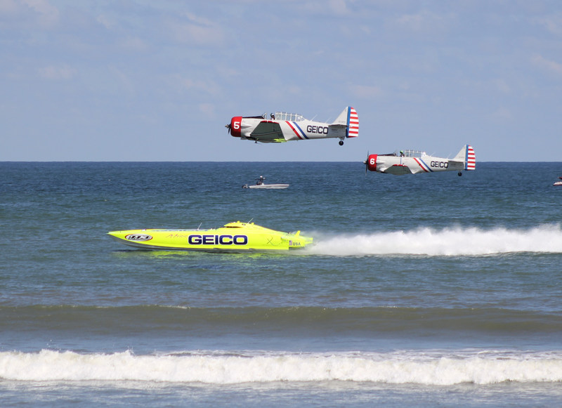 Eight-time world champion Miss GEICO races the #5 and #6 plane from the GEICO Skytypers Air Show Team. The powerboat is raced by Driver Marc Granet and Throttleman Scott Begovich. The solo aircraft are flown by #5 Tom Daly and #6 Kevin Sinibaldi.