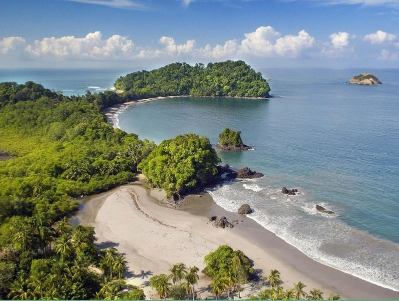 Manuel Antonio National Park, located on Costa Rica's Pacific Coast, is characterized by dense vegetation spilling onto the beaches' clean white sand. With annual temperatures ranging in the 70's, the beaches are a pleasant stop year round.