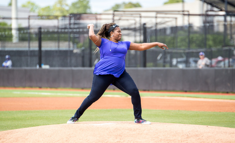 Wounded veteran Taniki Richard throws out the first pitch for the East Carolina University Pirates, at a recent Wounded Warrior Project event.