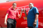 Baseball Legend Tim Raines and Jean Gagnon, Corporate Affairs Director at Labatt, raise a Bud to celebrate the passion of Montreal baseball using the new limited-edition Budweiser collection cans featuring Moises Alou, Vladimir Guerrero and Tim Raines. (CNW Group/Budweiser)