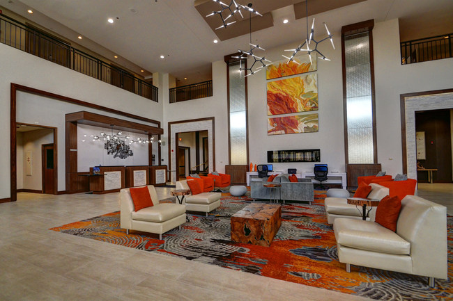Guests at the Delta Hotels Chicago North Shore enjoy vibrant lobby décor and colorful accents.