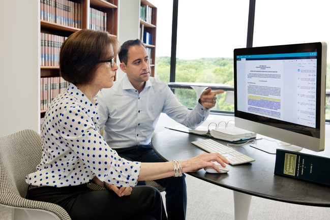 June 14, 2017: At IBM's T.J. Watson Research Center in Yorktown Heights, N.Y., Promontory Financial Group Managing Director Susan Krause Bell and IBM Vice President Marc Andrews are part of the team training Watson with an initial 60,000 U.S. regulatory citations. IBM has introduced the first expertly trained suite of Watson solutions to help financial institution professionals manage their regulatory and fiduciary responsibilities. (Credit: Connie Zhou for IBM)