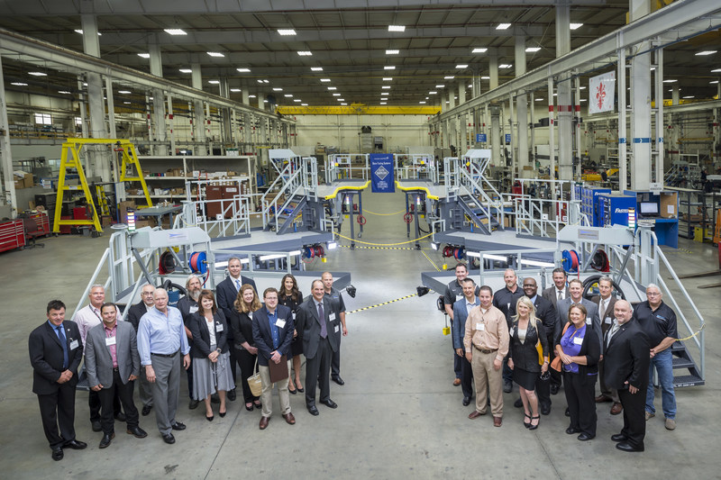 After the Elite Supplier award ceremony, visitors from Lockheed Martin, Michigan government and local trade organizations toured the Global Tooling Systems facility and stopped for a photo with an F-35 work stand.