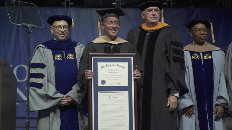 Jordan Zimmerman receiving an honorary degree of Doctorate of Business Administration