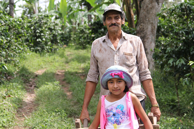 Gustavo Adolfo Talavera Herrera, a father of eight who grows coffee on 20 acres of his farm in Jinotega, Nicaragua, with his granddaughter, Maryering. Gustavo is one of the producers for LWR Farmers Market Coffee.