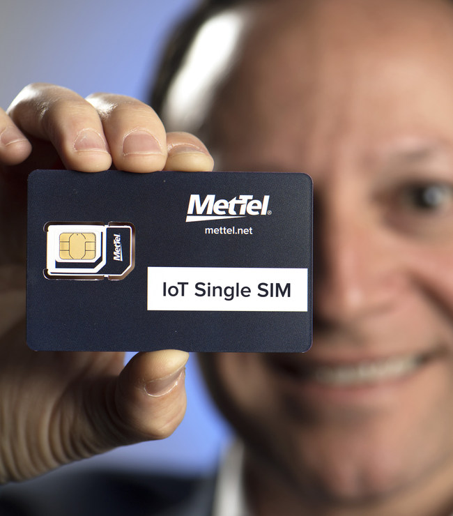 MetTel Vice President for Mobility and IoT, Max Silber, displays the IoT Single SIM which self-reports real-time on-session activity, providing a current view of product/component status and location on anything from a mobile phone to a jet engine on Thursday, June 15, 2017, in NYC. (Jon Simon/Feature Photo Service for MetTel)