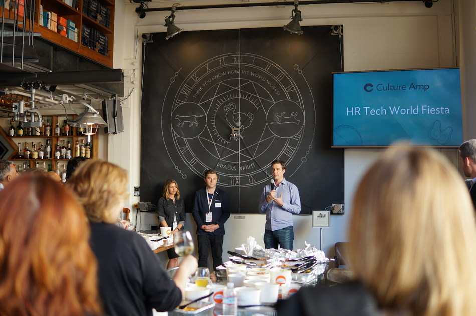 Culture Amp CEO Didier Elzinga announces the closing of Culture Amp's $20 Million Series C round at the company's event at the HR Tech conference in San Francisco