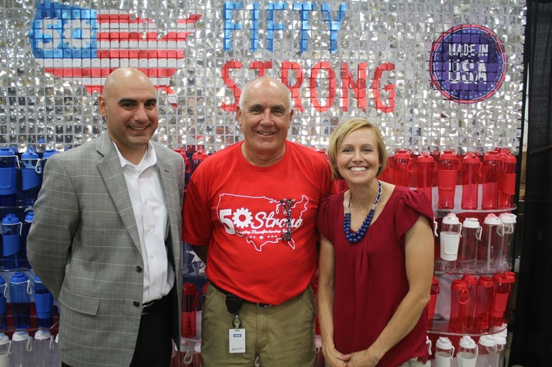 Walmart Regional General Manager Jason Leisenring, Randy Carter, Chairman, 50 Strong and Ashley Thompson, CEO, 50 Strong at 50 Strong's factory in Lima, OH celebrate their shared commitment to  U.S. manufacturing and Made in America products. Walmart selected 50 Strong to manufacture five million water bottles, which had previously been made by a Chinese competitor.