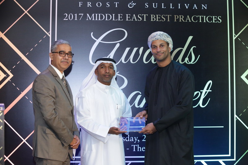 Mr. Fareed Al Hinai, Vice Chairman, ICT Health LLC receiving the 2017 UAE Healthcare IT Service Provider of the Year Award from Mr. Jamal Ramadhan Bin Marghoob, Director Marketing & Corporate Communications, Dubai Airport Freezone, in the presence of Mr. Sandeep Sinha, Vice President, Transformational Health Practice, Frost & Sullivan