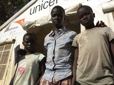 Refugees reunited. Two South Sudanese boys who walked unaccompanied for two weeks after their father was murdered and their mother was kidnapped are reunited with their older brother in Uganda. A World Vision case management centre is helping the brothers find foster parents. Photo/World Vision. (CNW Group/World Vision Canada)