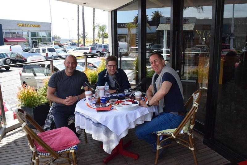 Pictured (left to right): Car enthusiasts Paul Zuckerman, Spike Feresten and Jerry Seinfeld chat on the porch of the Malibu Kitchen, with an empty chair for the listener to join the conversation
