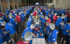 Accenture employees box 15,200 pounds of hunger relief packages, for a total of 100,000 meals donated by the company to the Daily Bread Food Bank during Accenture's annual employee meeting in Toronto, Ont. on Friday, June 16, 2017.   The Canadian Press Images PHOTO/Accenture (CNW Group/Accenture)