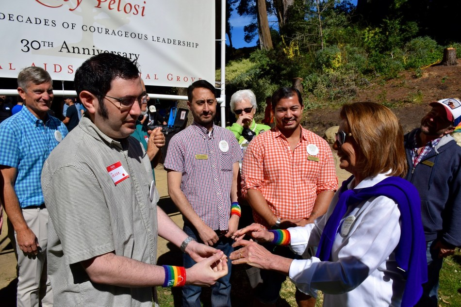 (L-R) Jesse Burgheimer meets Congresswoman Nancy Pelosi as she joins hundreds of volunteers at the National AIDS Memorial, San Francisco, CA for a community volunteer workday to commemorate her 30 years in Congress.  (Photo Credit: Melvin Morris)