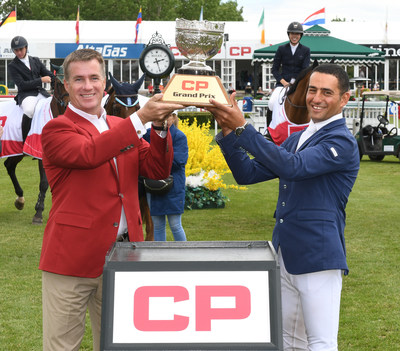 Keith Creel, CP President and Chief Executive Officer, presents the CP Grand Prix trophy to Sameh El Dahan. (CNW Group/Canadian Pacific)