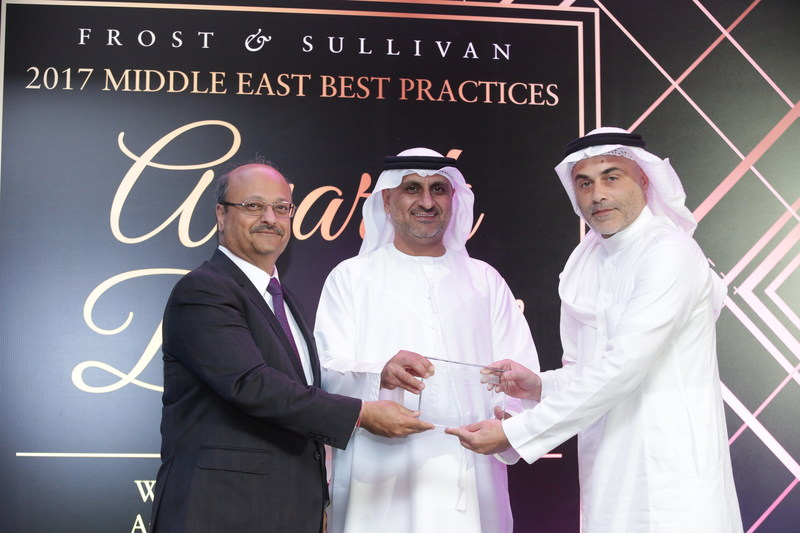 Mr. Numay Alsharif, Chief Operating Officer, Wared Logistics receives the '2017 KSA Emerging Domestic Road Transportation Service Provider of the Year' Award from Eng. Mahmood Al Bastaki, Board Member & CEO, Dubai Trade FZE, in presence of Mr. Aroop Zutshi, Global President & Managing Partner, Frost & Sullivan