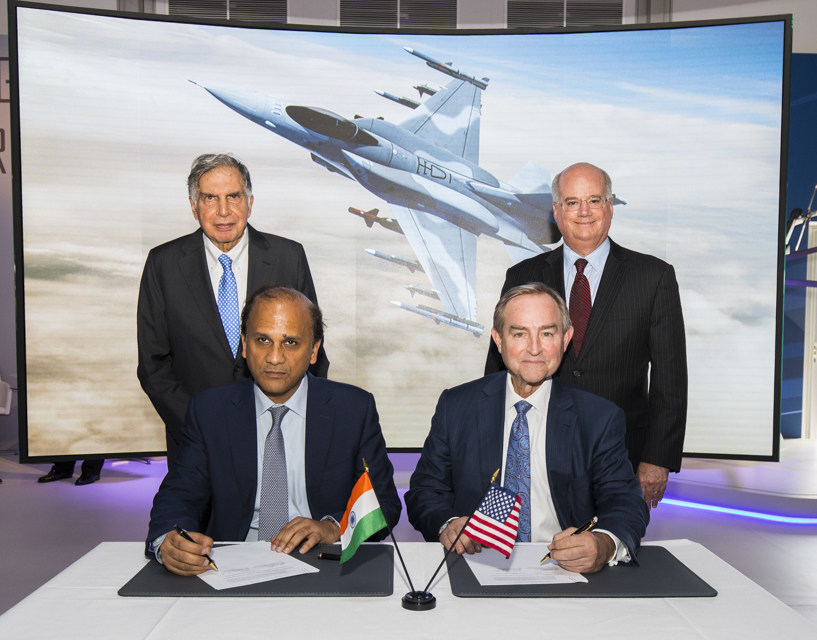 Sukaran Singh, CEO of Tata Advanced Systems Limited, (seated left) and George Standridge, vice president of Strategy and Business Development, Lockheed Martin Aeronautics, sign a letter of intent to produce the F-16 Block 70 in India. Standing are Mr. Ratean Tata, Chairman Emeritus, Tata Sons, and Orlando Carvalho, executive vice president of Lockheed Martin Aeronautics. (Lockheed Martin photo)