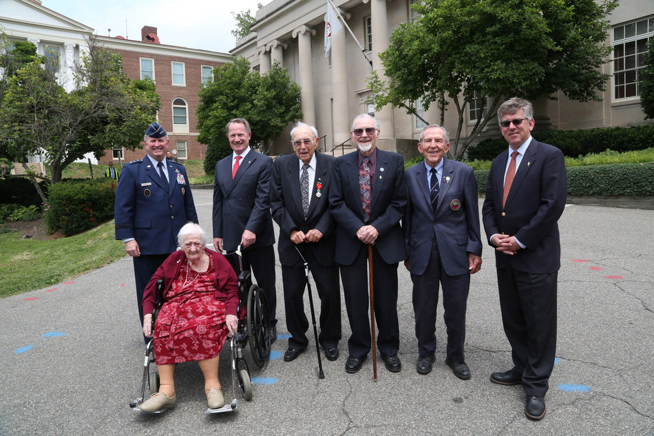 (l to r) Marion Frieswyk, Lt. Gen. Thomas Trask, Amb. Daniel Smith, Paul Roberts, John Billings, Art Reinhardt and Charles Pinck in front of the OSS headquarters on Navy Hill in Washington, D.C., on June 16, 2017.
