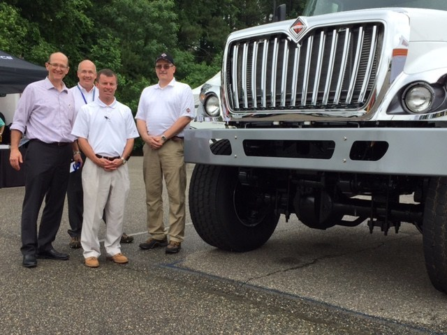 A WorkStar® truck fitted with the Fabco FSD-20 axle system was unveiled at the 2017 EUFMC show in Williamsburg, VA. Pictured L to R: John Conner, VP, Marketing, Fabco Automotive, Joe Stinson, Account Manager, Fabco Automotive, Terry Moran, Manager of Vocational Fleet Sales for Navistar and Bob Mann, Director of Vocational Sales, also for Navistar.