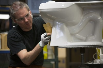 Precision manufacturing of a toilet at the Mansfield Plumbing facility in Ohio.