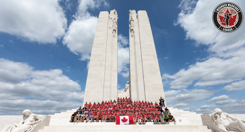 150 riders pose in front of the Canadian National Vimy Memorial (CNW Group/Wounded Warriors Canada)