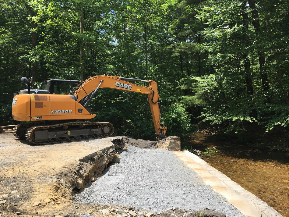 A CASE excavator works on the Old Forge Bridge project near Quincy Township, Pennsylvania!