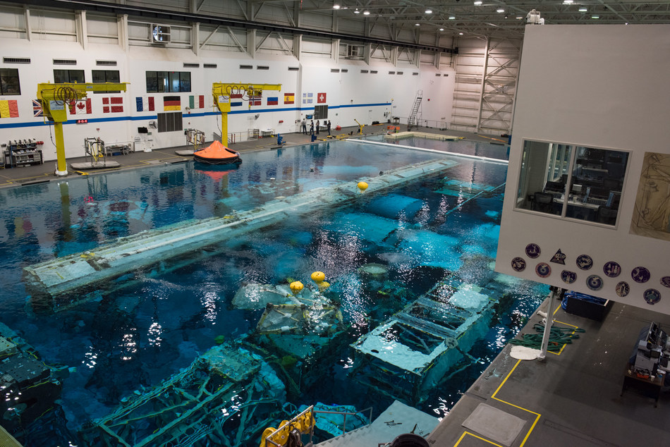 NASA's Neutral Buoyancy Laboratory (NBL) in Houston, Texas. The NBL is the pool NASA uses for astronaut spacewalk training and testing scenarios and new equipment. Raytheon provides maintenance and operations support at the facility.