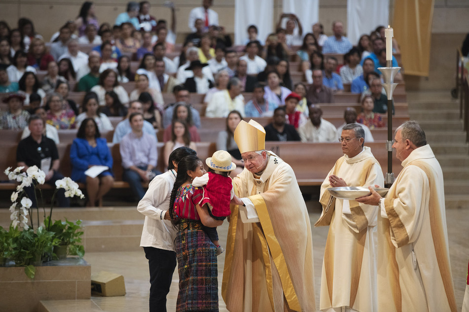 Mayan family of Guatemala receives a blessing from Archbishop José H. Gomez during the presentation of the gifts at the Mass in Recognition of All Immigrants at the Cathedral of Our Lady of the Angels in Los Angeles on Sunday, June 18, 2017.