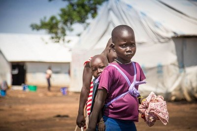 A South Sudanese refugee girl in Uganda wearing a yellow bracelet to indicate that she is an at-risk child. World Vision is conducting child protection assessments around the clock to assist the more than one hundred unaccompanied children crossing the border each day. Photo/World Vision (CNW Group/World Vision Canada)