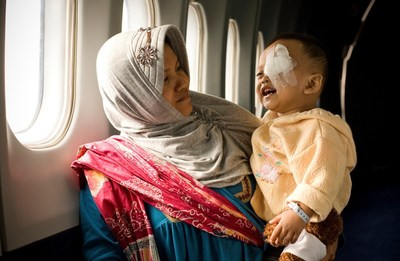 A young patient smiles after receiving treatment on board the Orbis Flying Eye Hospital during a stop in Indonesia. Photo credit: Geoff Oliver Bugbee/Orbis. (Additional hi-res photos available upon request.)