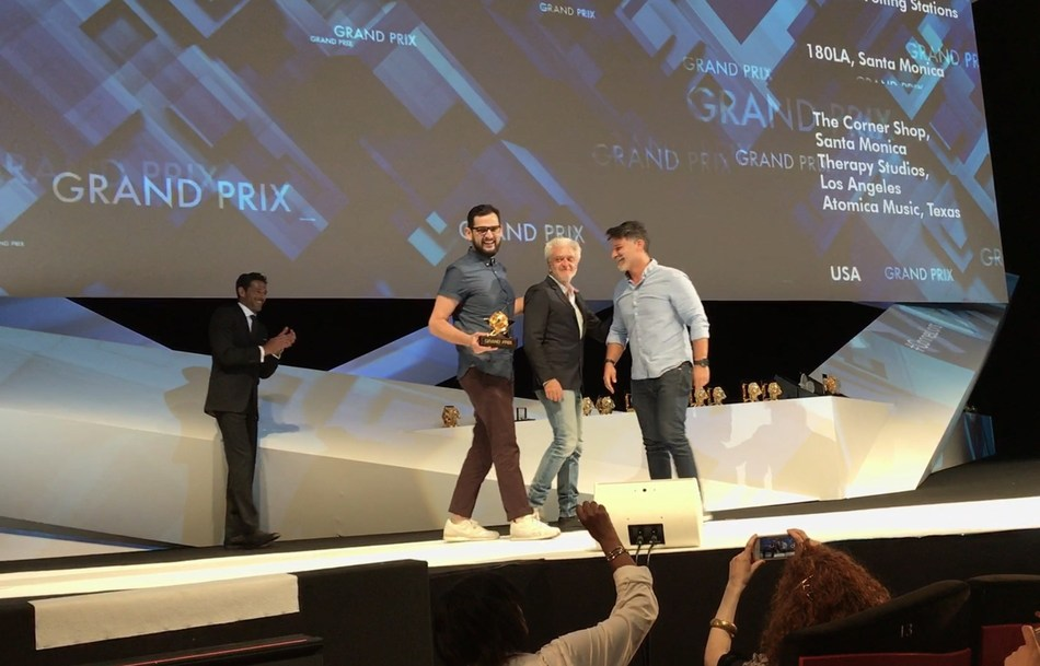 Executive Creative Directors Rafael Rizuto (L) and Eduardo Marques (R) accept the Cannes Lions Grand Prix for Promo and Activation from Jury President Stephane Xiberras on behalf of 180LA for Boost Mobile's Boost Your Voice campaign at the 2017 Cannes Lions Festival.