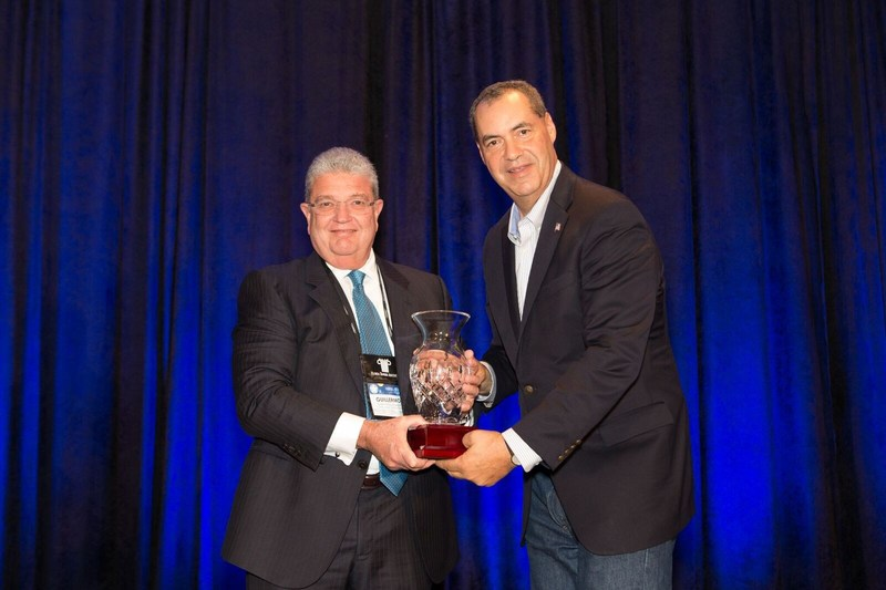"Guillermo Diaz-Rousselot, President and CEO of Continental National Bank receiving the award ""2017 Banker of the Year"" by The Florida Bankers Association's President and CEO Alex Sanchez."