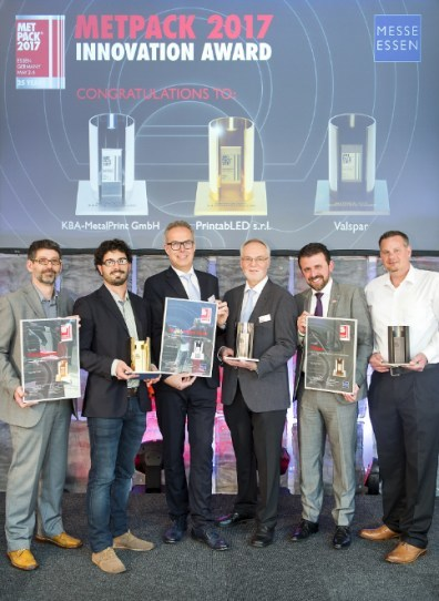 The photo shows Flavio Marchi, global marketing director, Valspar Packaging (second from right) and Jeff Niederst, technical director, Valspar Packaging EMEAI (far right) posing with the other award winners.