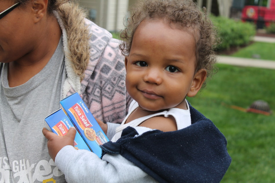 Child taking home StarKist(R) at a Feed the Children community event