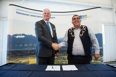 Craig Richmond (L) President and CEO of YVR Airport and Chief Wayne Sparrow of the Musqueam Indian Band sign the Musqueam Indian Band-YVR Airport Sustainability & Friendship Agreement joint announcement at YVR in Richmond, British Columbia on June 21, 2017. (BEN NELMS for National Post) (CNW Group/Vancouver Airport Authority)