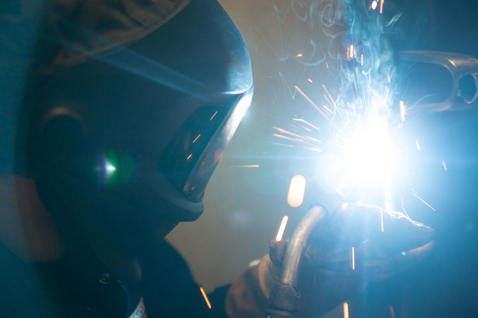 Welding Student Nick Peterson practices metal inert gas, or MIG, welding.