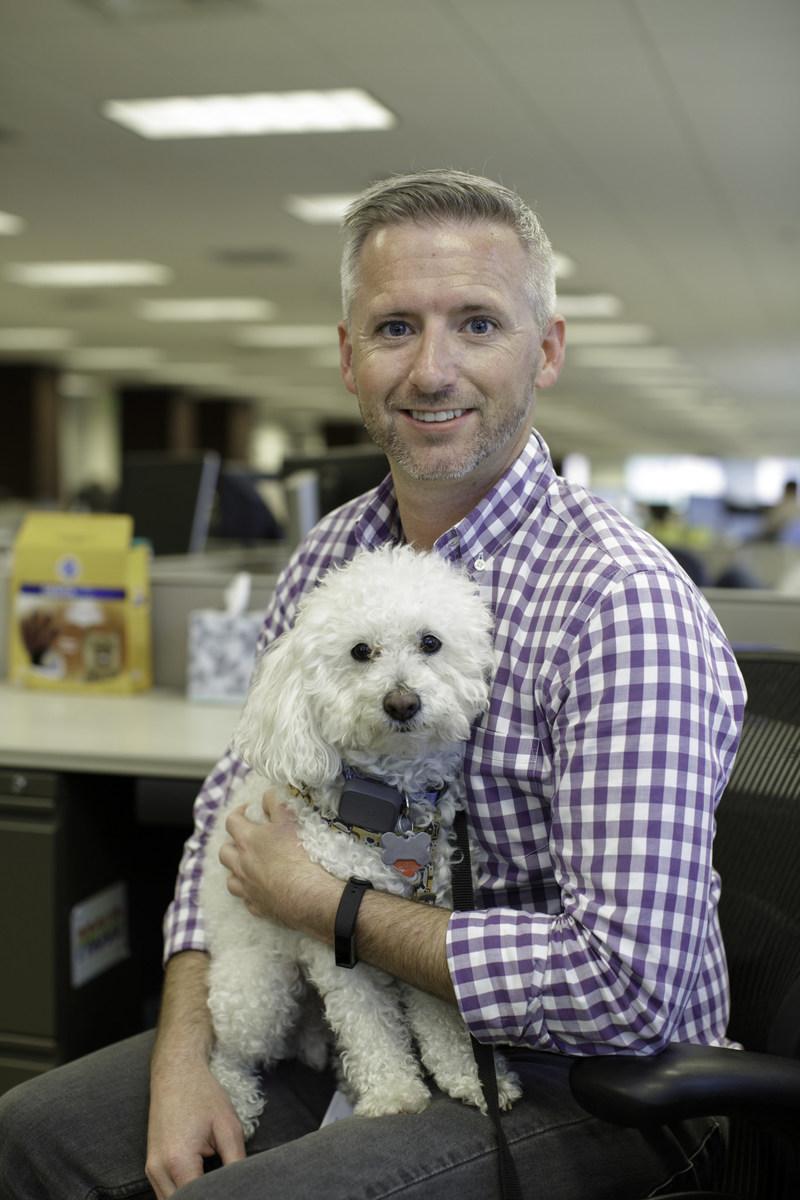 Mars Petcare Associate Tim Wingard and his pup Sparky.