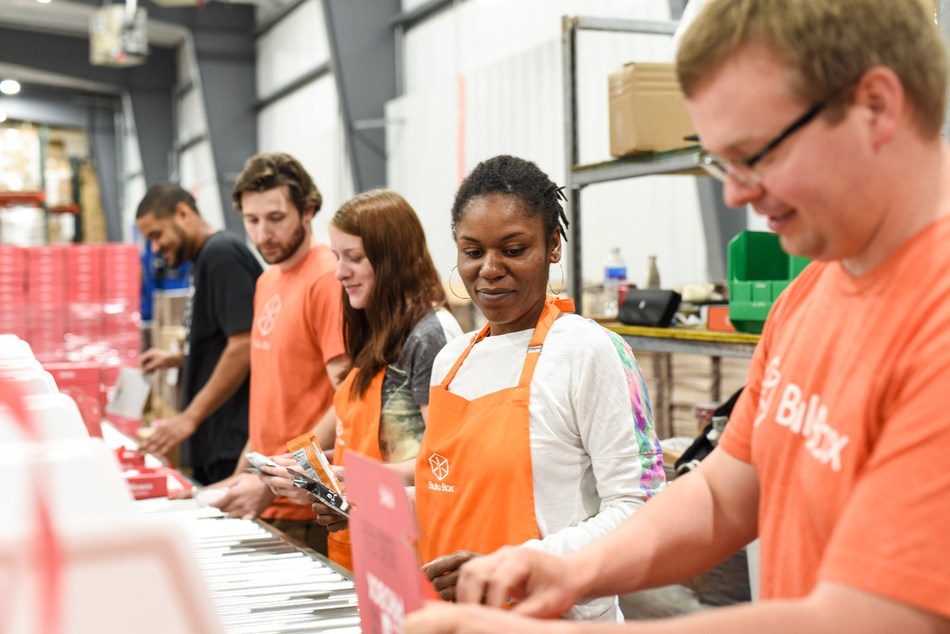 The Bulu Box warehouse team packs subscription boxes for a Turnkey Subscription Box Solutions partner.