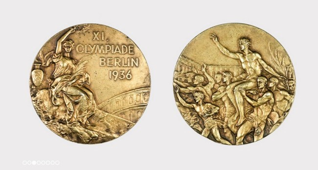 """Obverse and reverse views of Olympic Gold Medal won by John H. """"Tex"""" Gibbons, captain of the U.S. Men's Basketball Team at the Olympic Games held in 1936 in Berlin, Germany. Family provenance. Accompanied by LOA signed by Gibbons' son, Donald E. Gibbons. Estimate $100,000-$150,000"""