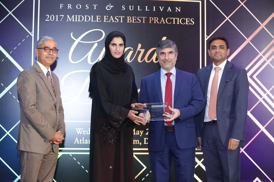 Dr. Nader Darwich, Medical Director, Healthpoint, Head of the Department of Orthopedics and Sports Medicine at Healthpoint and Founder of the Abu Dhabi Knee and Sports Medicine Center receives the '2017 UAE Emerging Orthopedics Service Provider of the Year' Award from Mr. Akshay Agarwal, Executive Director - Private Equity, Waha Capital in the presence of Mr. Sandeep Sinha, Vice President, Transformational Health Practice, Frost & Sullivan