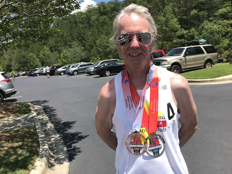 Greg Tooker with some of his medals from the Senior Games.
