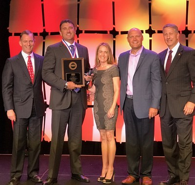 Robert Blankenship accepts the National Quality Dealer of the Year award from the NIADA.