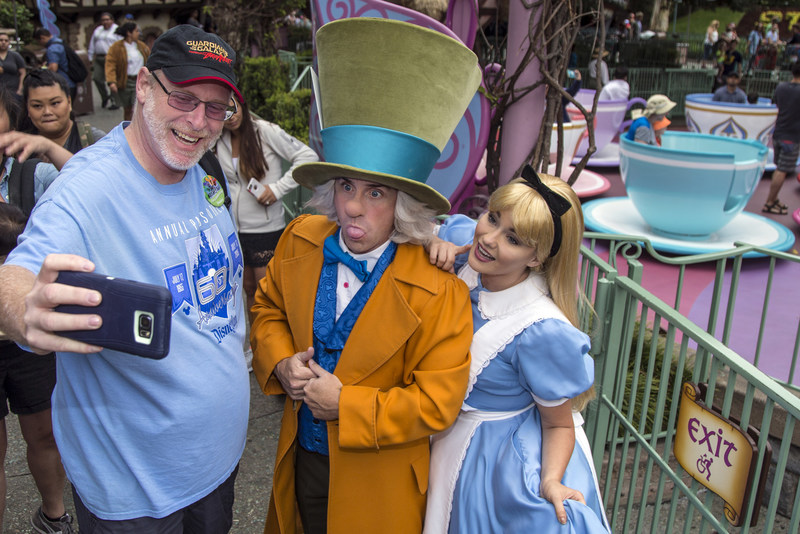 ANAHEIM, Calif. (June 22, 2017) Huntington Beach resident Jeff Reitz, who has visited the parks of the Disneyland Resort every day since January 1, 2012, marked a milestone of Super Hero proportions--his 2,000th consecutive visit–on Thursday, June 22. Jeff snaps a selfie with the Mad Hatter and Alice in Wonderland in Disneyland Park.