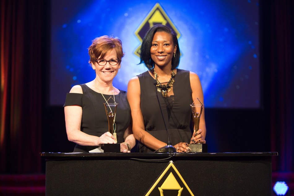 Eugenia Buggs and Julie Jamsa of Generali Global Assistance accept one of the Company's three Stevie Awards.