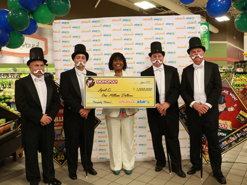 Star Market customer April Carrington celebrates her $1 million prize.