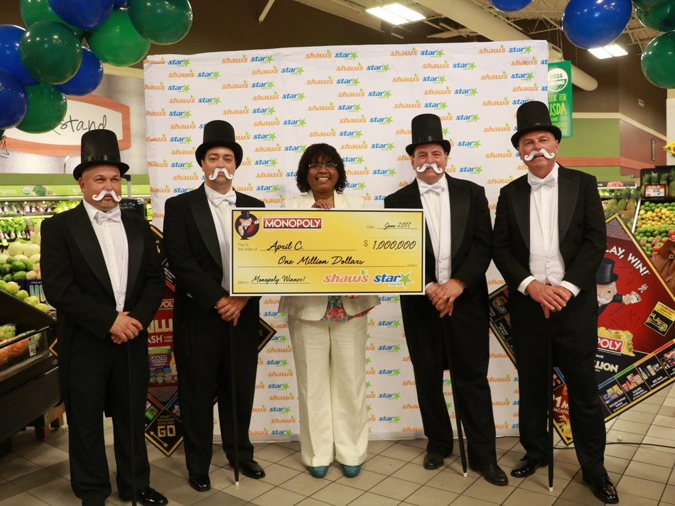 Star Market customer April Carrington celebrates her $1 million prize.