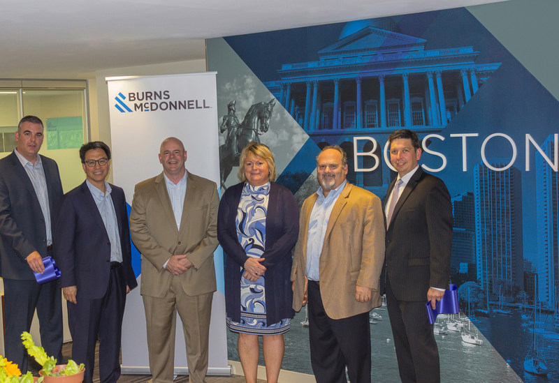 Burns & McDonnell celebrates the opening of its Greater Boston office with a ceremonial ribbon cutting with Newton Economic Development Director Kathryn Ellis (center). Pictured left to right: Jeff Buckley, Jerry Fan, Chris Courtright, Kathryn Ellis, Brett Williams and Rob Young.