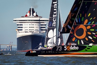 """Cunard's Queen Mary 2 in French port city of Saint Nazaire, embarking on Transatlantic """"Race"""" against four trimarans, including the Class Ultim 'Team Actual' of French skipper Yves Le Blevec and Sodebo Ultim with French skipper Thomas Coville at the start of 'The Bridge 2017' on June 25, 2017."""